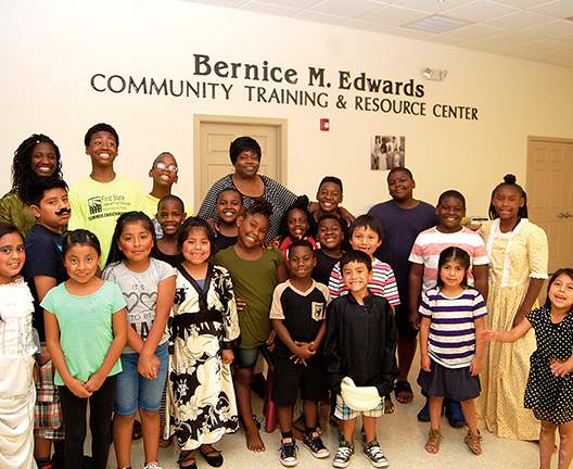 Bernice Edwards and the Children at First State Communtiy Action Center