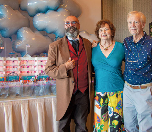 Artist Timothy Credle and Boardwalk Plaza owners Ruth Ann and Jeff Zerby.